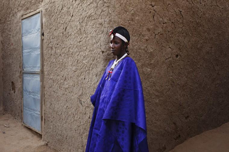 Fatoumata Toure, 15, wears a traditional Songhai headdress made by artisan Hally Bara in Gao, Mali, March 6, 2013. (Joe Penney/Reuters)
