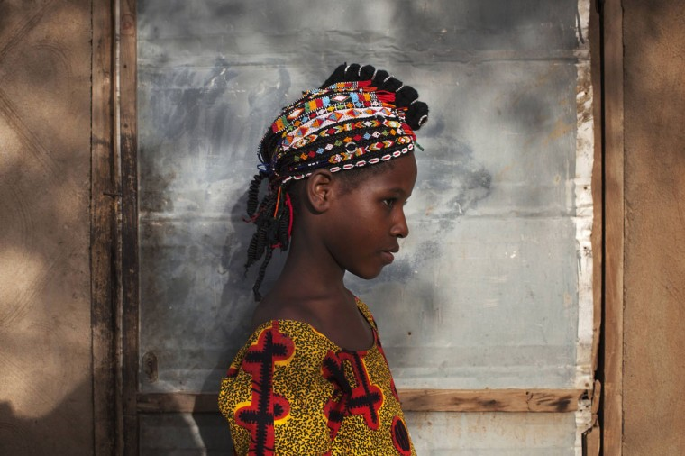 Safiatou Maiga, 8, wears a traditional Songhai headdress made by artisan Hally Bara in Gao, Mali, March 6, 2013. (Joe Penney/Reuters)