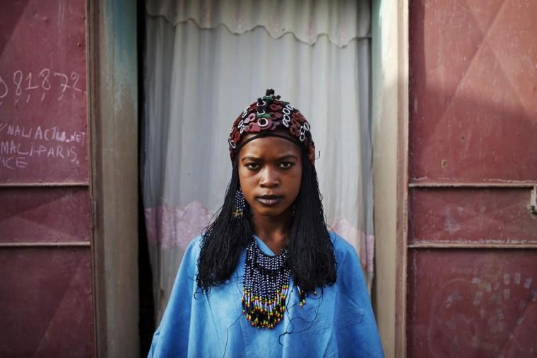 Fady DIcko, 14, wears a traditional Tuareg headdress made by artisan Hally Bara in Gao, Mali, March 6, 2013. (Joe Penney/Reuters)