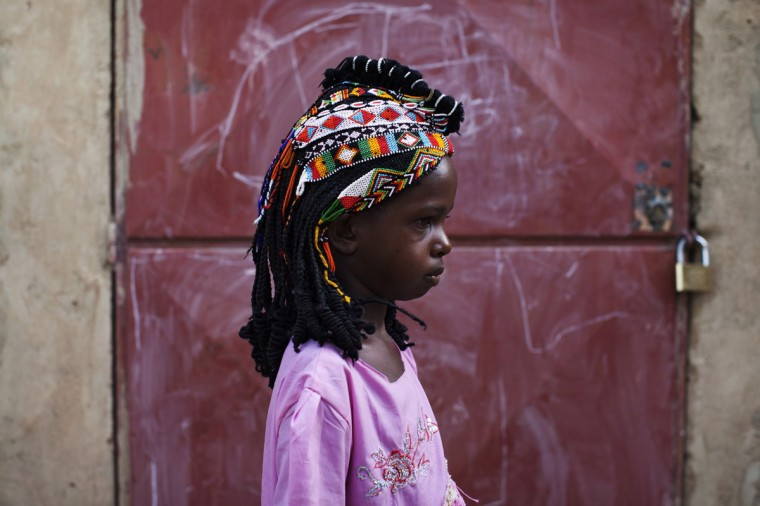 Aminata Toure, 10, wears a traditional Songhai headdress made by artisan Hally Bara in Gao, Mali, March 6, 2013. (Joe Penney/Reuters)