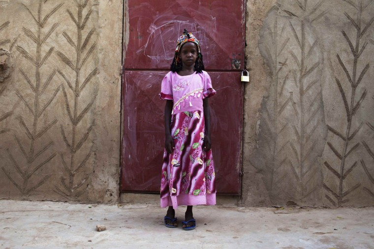 Aminata Toure, 10, wears a traditional Songhai headdress made by artisan Hally Bara in Gao, Mali, March 6, 2013. (Joe Penney/Reuters)