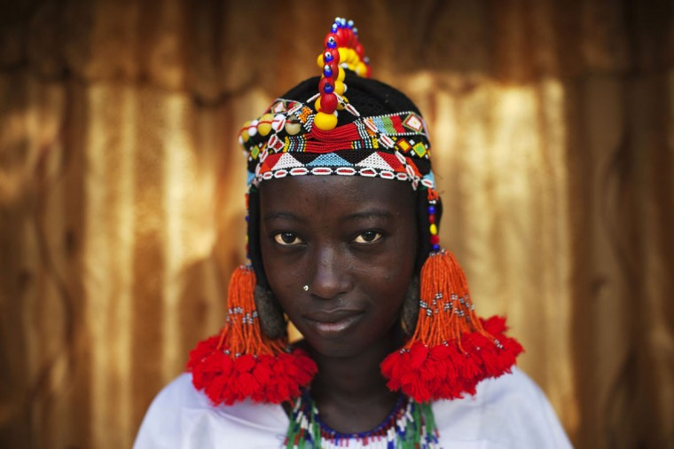 Balkissa Maiga, 17, wears a traditional Songhai headdress made by artisan Hally Bara in Gao, Mali, March 6, 2013. (Joe Penney/Reuters Photo)