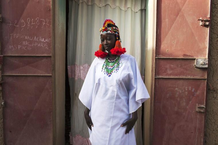 Balkissa Maiga, 17, wears a traditional Songhai headdress made by artisan Hally Bara in Gao, Mali, March 6. 2013. (Joe Penney/Reuters)