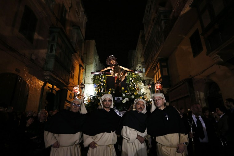 """March 27, 2013: The """"miraculous"""" Ta' Giezu (of Jesus) crucifix is carried during the Via Crucis, the Way of the Cross, during Holy Week in Valletta. Legend has it that in 1630, the artist Fra Umile had racked his brains to try and depict Christ at his greatest hour of pain, but while he slept the head of Christ was completed by an angel. (Darrin Zammit Lupi/Reuters)"""