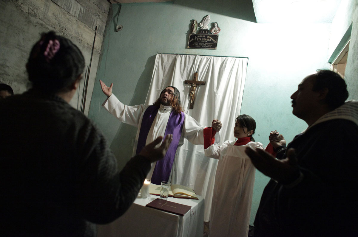 "Catholic priest Adolfo Huerta, known as ""Gofo"", conducts a mass in"
