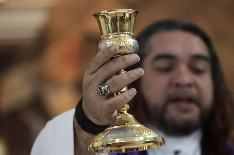 Catholic priest Adolfo Huerta conducts a mass in Saltillo February 27, 2013. (Daniel Becerril/Reuters)