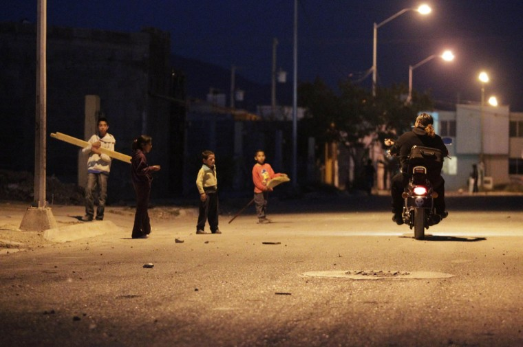 Catholic priest Adolfo Huerta stops his motorcycle to ask for directions in Saltillo February 26, 2013. (Daniel Becerril/Reuters)