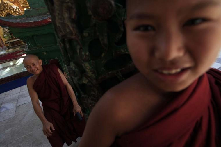 Buddhist monks sit at a temple near Shwedagon Pagoda in Yangon March 18, 2013. (Soe Zeya Tun/Reuters)