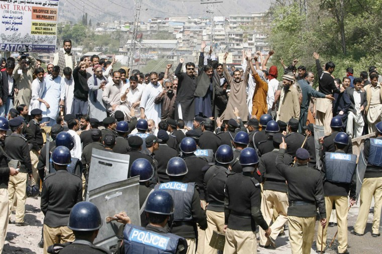 Protesters shout slogans during a demonstration against power outage in Muzffarabad, capital of Pakistan-administrated Kashmir. People protesting against power outage in Muzaffarabad turned violent on Thursday. Around 50 people, including a police official, sustained minor injuries when the protesters pelted stones at the police and burnt a police bus, local media reported. (Amiruddin Mughal/Reuters)