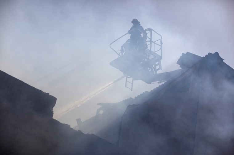 A fireman attempts to put out a fire that broke out at a garment factory in Karachi. According to a factory worker, no casualties were reported from the fire that broke out in the garment factory in the federal b. industrial area of Karachi. (Akhtar Soomro/Reuters photo)