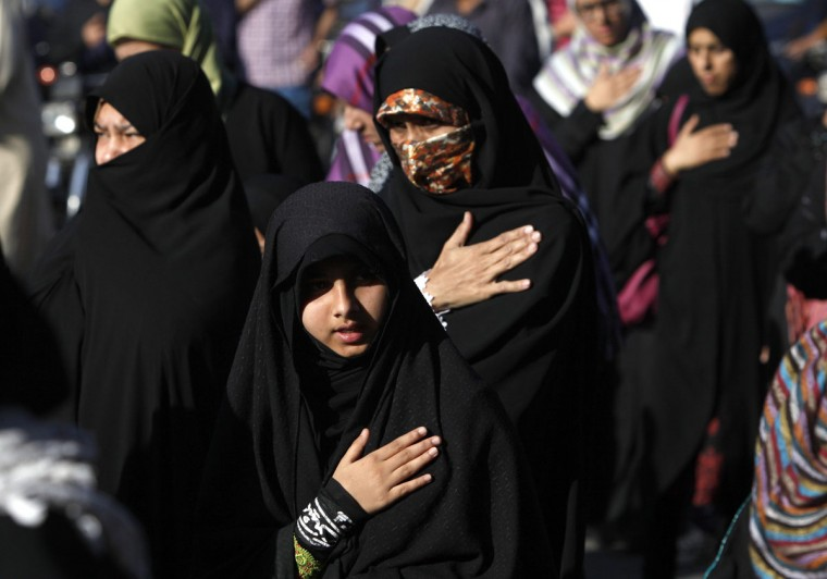 Shi'ite Muslim women beat their chest during a protest rally organized by the religious group, Shia Qaumi Mahaz (SQM), in Karachi March 8, 2013. The rally was held to condemn a bomb blast on Sunday which killed at least 45 people. (Akhtar Soomro/Reuters)