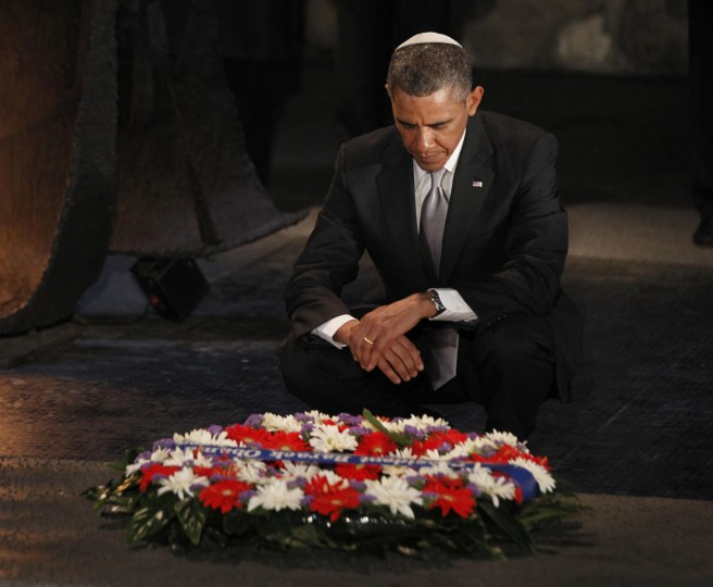 U.S. President Barack Obama pauses for a moment as he lays a wreath at the Hall of Remembrance during his visit to the Yad Vashem Holocaust Memorial in Jerusalem. (Jason Reed/Reuters)