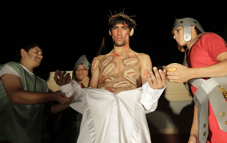 "March 27, 2013: Actors take part in a ""Via Crucis"" (Way of the Cross) re-enactment of the Last Supper during Holy Week, in preparation for Good Friday celebrations, in Luque, Paraguay. (Jorge Adorno/Reuters)"