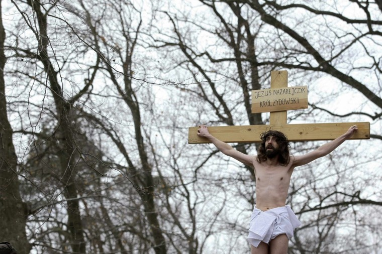 """March 29, 2013: Polish catholic devotees re-enact the """"Way of the Cross"""" on Good Friday as part of Holy Week celebrations at the Kalwaria Wejherowska in Wejherowo near Gdansk, northern Poland. (Kacper Pempel/Reuters)"""
