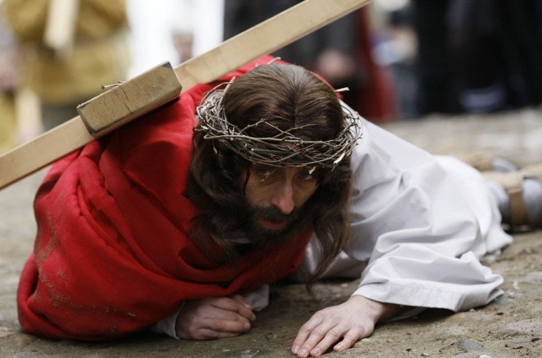 """March 29, 2013: Polish catholic devotees re-enact the """"Way of the Cross"""" on Good Friday as part of Holy Week celebrations at the Kalwaria Wejherowska in Wejherowo, near Gdansk, northern Poland. (Kacper Pempel/Reuters)"""