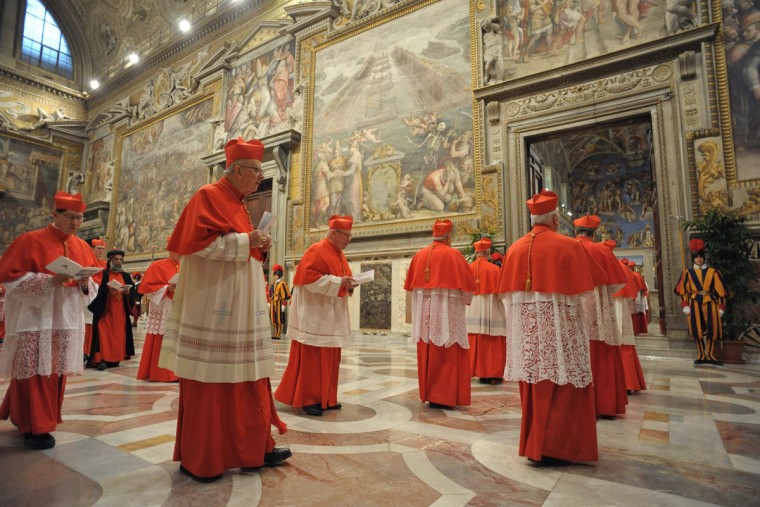 Cardinals enter the Sistine Chapel to begin the conclave in order to elect a successor to Pope Benedict XVI on March 12, 2013. (Osservatore Romano handout/Reuters)