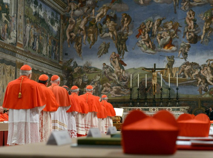 Cardinals enter the Sistine Chapel to begin the conclave in order to elect a successor to Pope Benedict on March 12, 2013. (Osservatore Romano handout/Reuters)