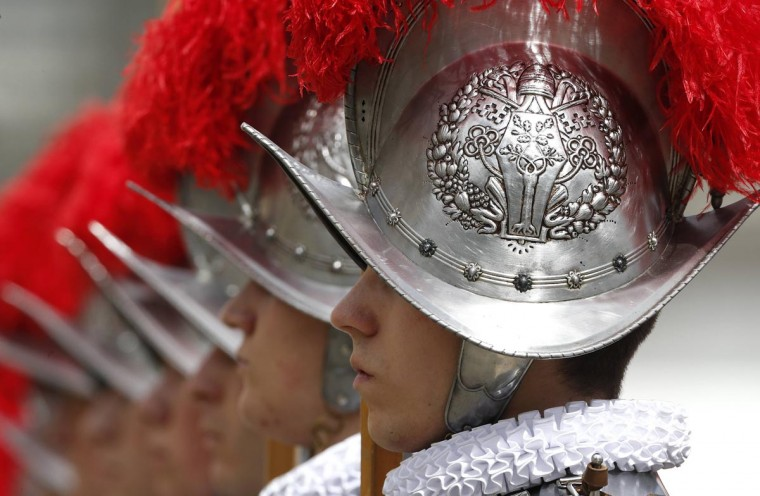 Swiss guards stand at attention at the end of the Easter mass led by Pope Francis in St. Peter's Square at the Vatican March 31, 2013. (Stefano Rellandini/Reuters)