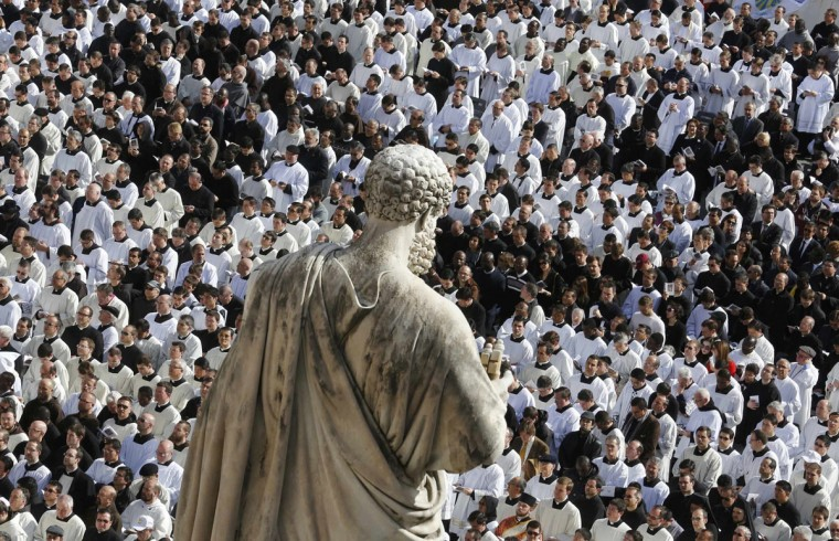 Members of the clergy are seen near a statue of Saint Peter during the inaugural mass of Pope Francis in Saint Peter's Square at the Vatican, March 19, 2013. (Stefano Rellandini/Reuters)
