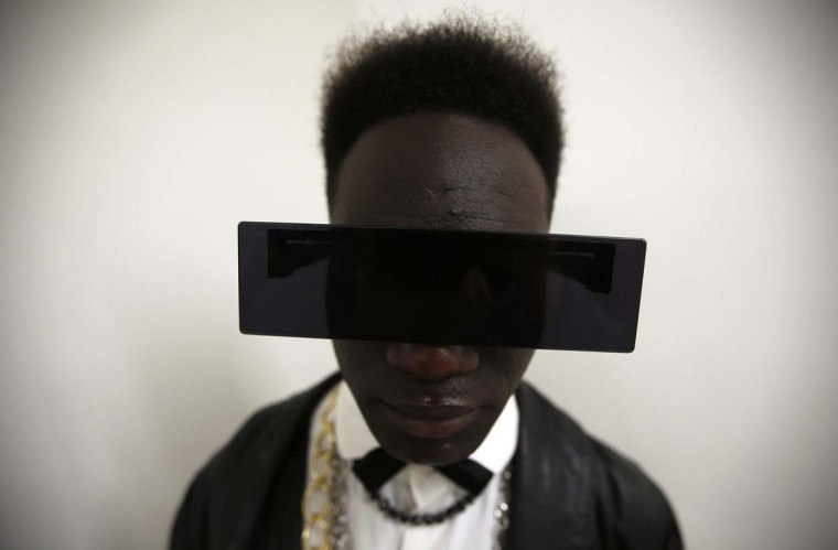 A visitor poses for a portrait during Lisbon Fashion Week March 9, 2013. (Rafael Marchante/Reuters)