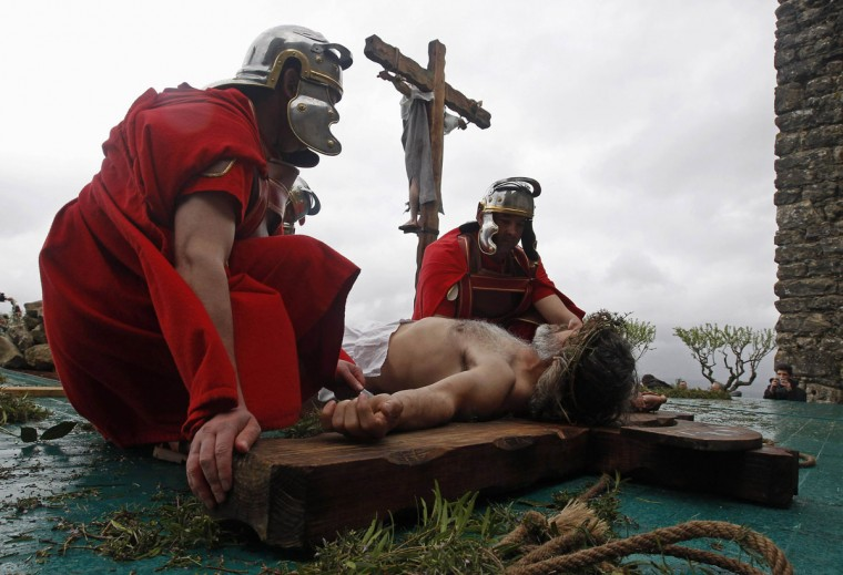 """March 29, 2013: Worshippers re-enact the """"Stations of the Cross"""" during a procession on Good Friday in Ourem, central Portugal. (Jose Manuel Ribeiro/Reuters)"""
