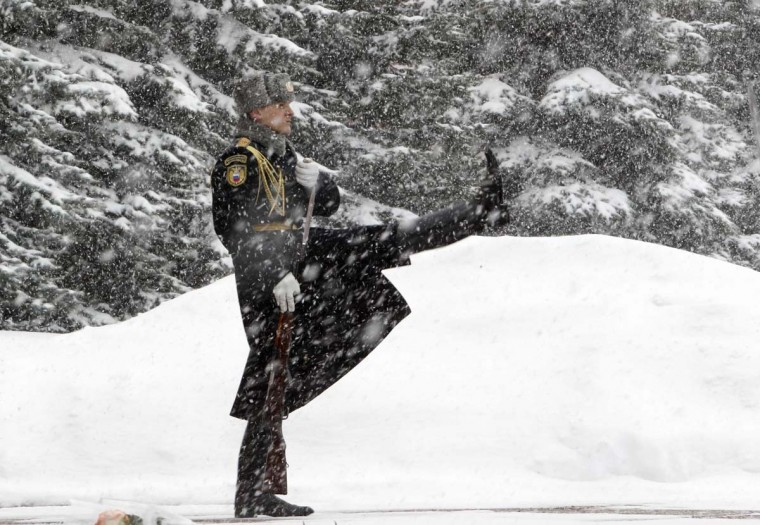 An honor guard marches during the changing of the guards ceremony at the Tomb of the Unknown Soldier by the Kremlin wall during snowfall in central Moscow, March 25, 2013. (Sergei Karpukhin/Reuters)