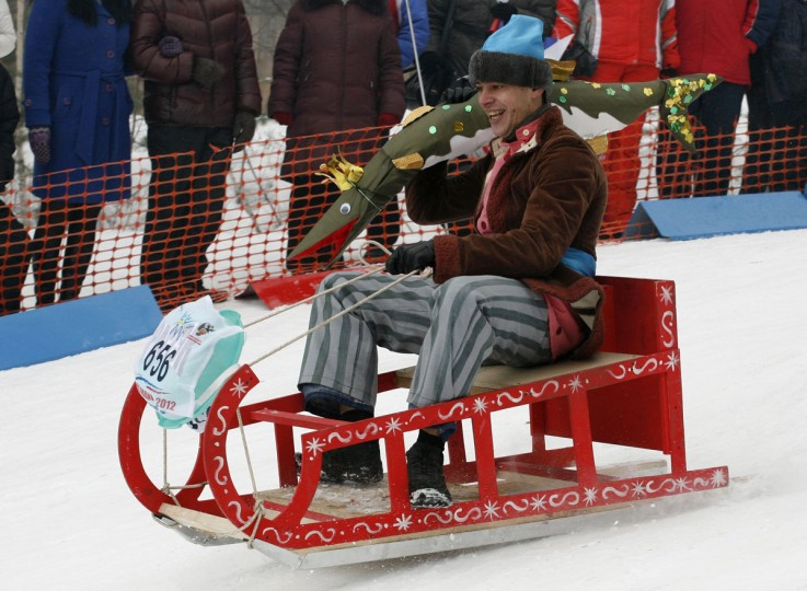 A participant competes during the 8th annual comic tobogganing competition, dedicated to the upcoming All Fools' Day and the end of a winter sports season, at the Vetluzhanka ski stadium on the suburbs of Russia's Siberian city of Krasnoyarsk, March 30, 2013. About 80 participants competed in tobogganing down from a snow slope on basins, baths, refrigerators and other items, according to organizers. (Ilya Naymushin/Reuters)