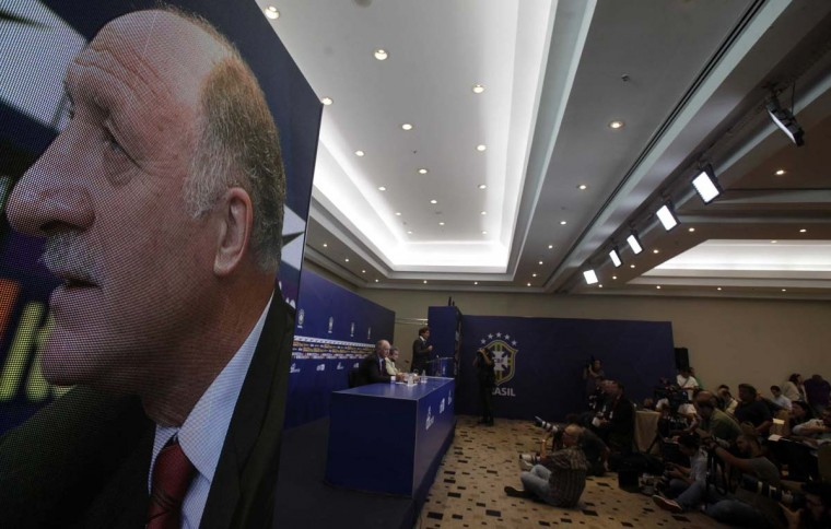 Brazilian national soccer team head coach Scolari is pictured onscreen during a news conference in Rio de Janeiro