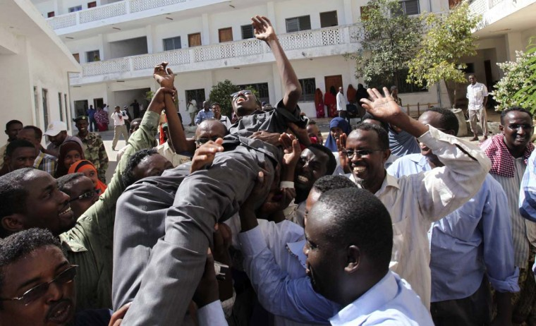 Somali journalists carry their colleague Abdiaziz Abdinur after the high court freed him in the capital of Mogadishu, March 17, 2013. A Somali judge on Sunday freed Abdinur who was jailed last month for interviewing an alleged gang-rape victim in a case that sparked international condemnation over how Somali authorities treat victims of sexual violence and press freedom. (Feisal Omar/Reuters)