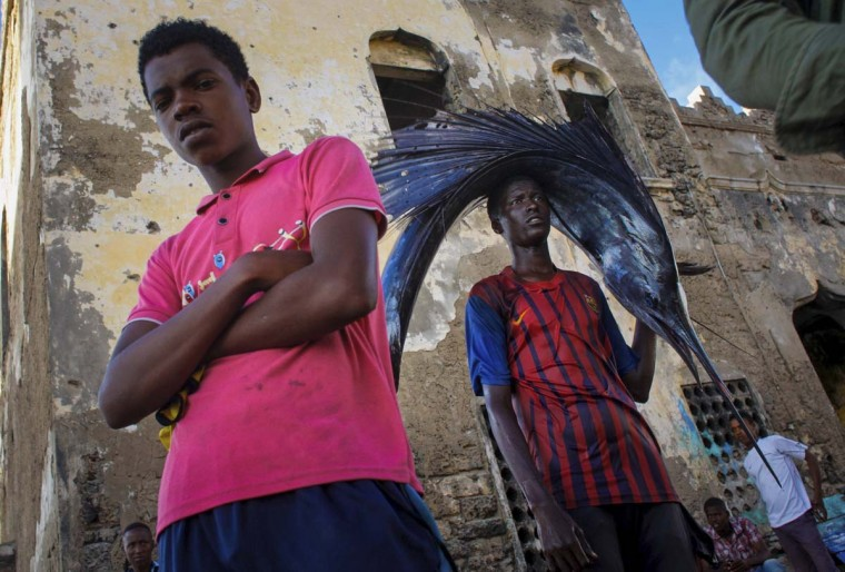 A Somali man pauses while carrying a large sailfish on his head as he transports it to Mogadishu's fish market in the Xamar Weyne district of the Somali capital, in this photo taken March 16, 2013. (Stuart Price/ AU-UN IST Photo via Reuters)
