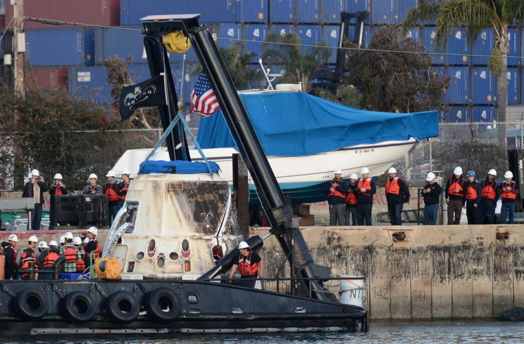Workers transport the SpaceX Dragon capsule, which splashed down off the coast of Baja California, Mexico on Tuesday, back to port in San Pedro, California. Dragon returned to Earth from the International Space Station with 2,668 (1,210 kg) of cargo, including a freezer filled with biological samples from the crew for medical research. (Gene Blevins/Reuters photo)
