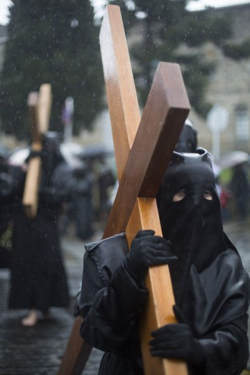 "March 29, 2013: Penitents take part in the procession of the ""Nuestra Senora de la Quinta Angustia"" brotherhood during Holy Week in Santiago de Compostela, northern Spain. (Miguel Vidal/Reuters)"