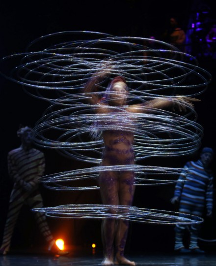 Artist Irina Akimova dances with hoops in this multiple-exposure picture as she performs during the Cirque du Soleil's Kooza show in Madrid February 28, 2013. (Sergio Perez/Reuters)