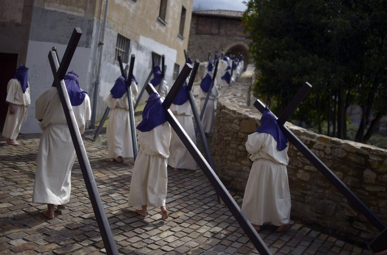March 29, 2013: Residents dressed as penitents take part in an Easter Passion Play on Good Friday in the Basque town of Balmaseda, Spain. (Vincent West/Reuters)