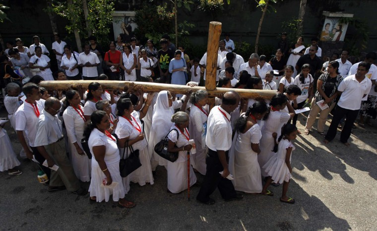 March 29, 2013: Catholics carry a holy cross at a street parade during a special Good Friday mass in Colombo, Sri Lanka. (Dinuka Liyanawatte/Reuters)