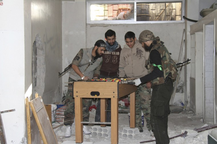 Free Syrian Army fighters play foosball in Sidi Meqdad area in the suburbs of Damascus. (Ward Al-Keswani/Shaam News Network/via Reuters)