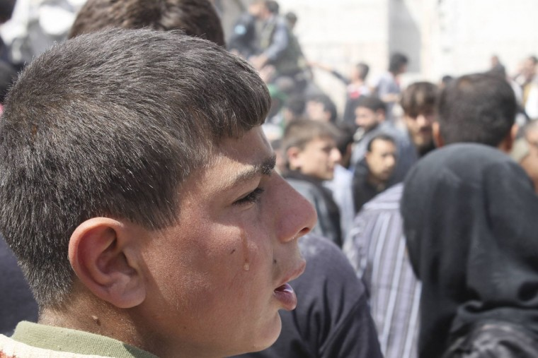 A boy cries while searching for casualties under the rubble at a site hit by what activists say was an air strike in Daiaat Al-Ansari neighborhood, Aleppo March 30, 2013. (Ziad Rev/Reuters)