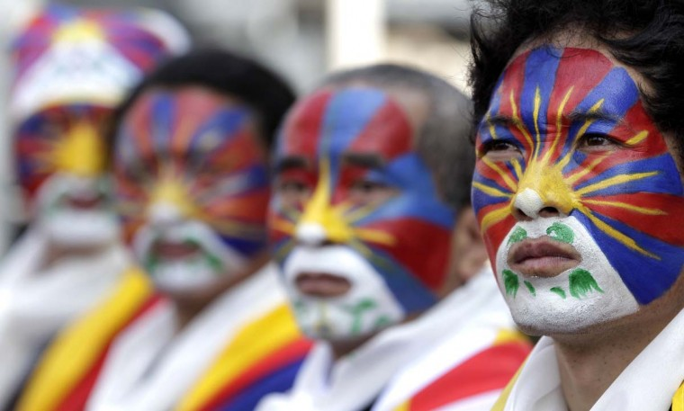 Activists with the colours of the Tibetan flag painted on their faces take part in a rally to support Tibet in Taipei March 10, 2013. Hundreds of Tibetans and their supporters in Taiwan marched the streets to commemorate the uprising in Lhasa 54 years ago against Chinese rule. (Pichi Chuang/Reuters)