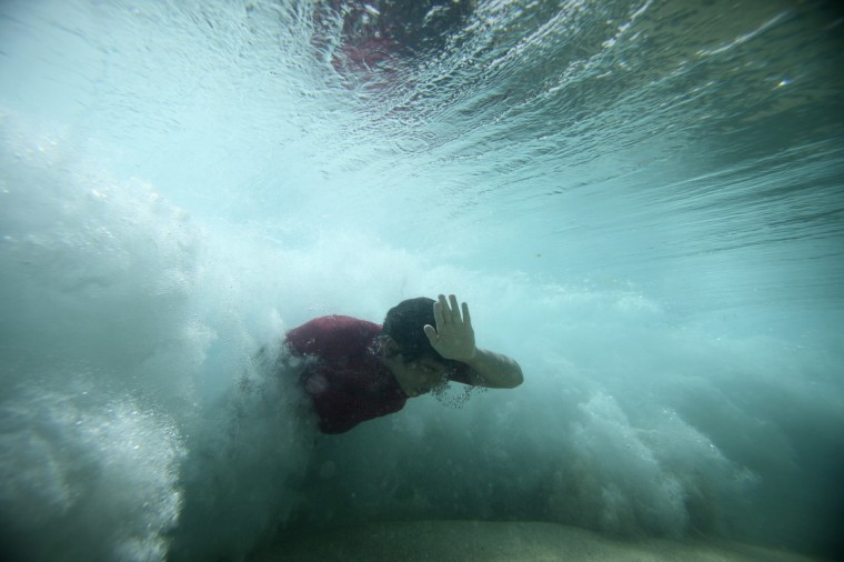 A bodysurfer punches through a wave at the Ehukai sandbar near the surf break known as 'Pipeline' on the North Shore of Oahu, Hawaii. (Hugh Gentry/Reuters)