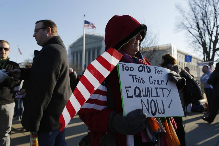 Diana Iwanski of Clermont, Florida, holds a sign to protest against the Defense of Marriage Act (DOMA) in front of the U.S. Supreme Court in Washington, March 27, 2013. (Jonathan Ernst/Reuters)
