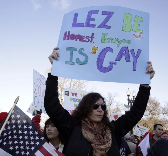 A demonstrator holds up a sign outside of the U.S. Supreme Court in Washington, March 26, 2013. (Joshua Roberts/Reuters)