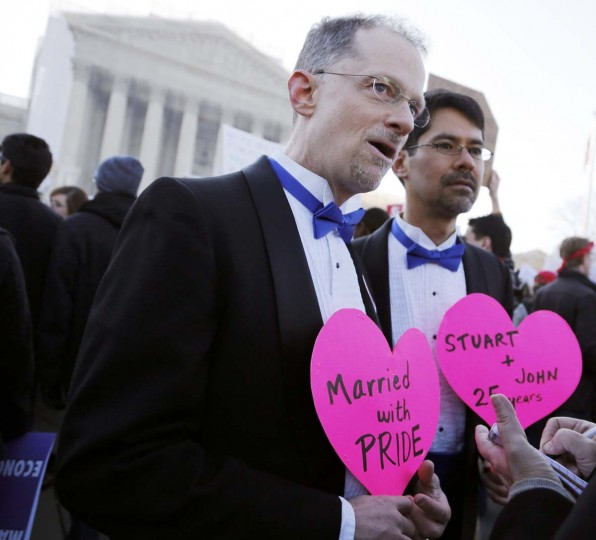 A gay couple is interviewed outside of the U.S. Supreme Court in Washington, March 26, 2013. (Jonathan Ernst/Reuters)
