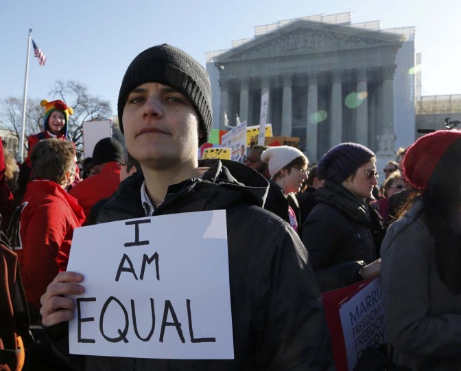 A demonstrator holds a sign outside of the U.S. Supreme Court in Washington, March 26, 2013. (Jonathan Ernst/Reuters)