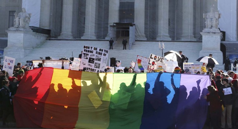 Anti-Proposition 8 protesters are shadowed by a rainbow banner in front of the U.S. Supreme Court in Washington, March 26, 2013. (Jonathan Ernst/Reuters)