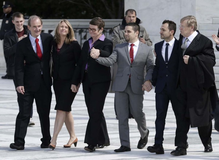 Attorneys David Bois (L) and Ted Olson (R), who argued against the California law Proposition 8, and plaintiffs Sandy Stier (2nd L) and Kris Perry (3rd L) and Paul Katami (3rd R) and (Jeff Zarrillo 2nd R) arrive to speak to the media after arguing their case before the Supreme Court in Washington March 26, 2013. (Joshua Roberts/Reuters)