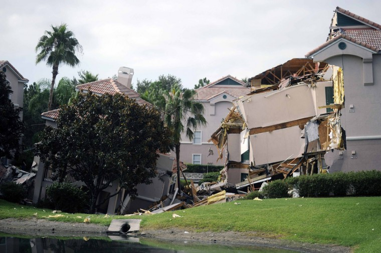 A section of the Summer Bay Resort lies collapsed after a large sinkhole opened on the property's grounds in Clermont, Florida August 12, 2013. Dozens of guests at the Florida resort near Walt Disney World were evacuated early Monday, when at least two buildings partially collapsed due to the sinkhole, guests and resort employees said. (David Manning/Reuters photo)