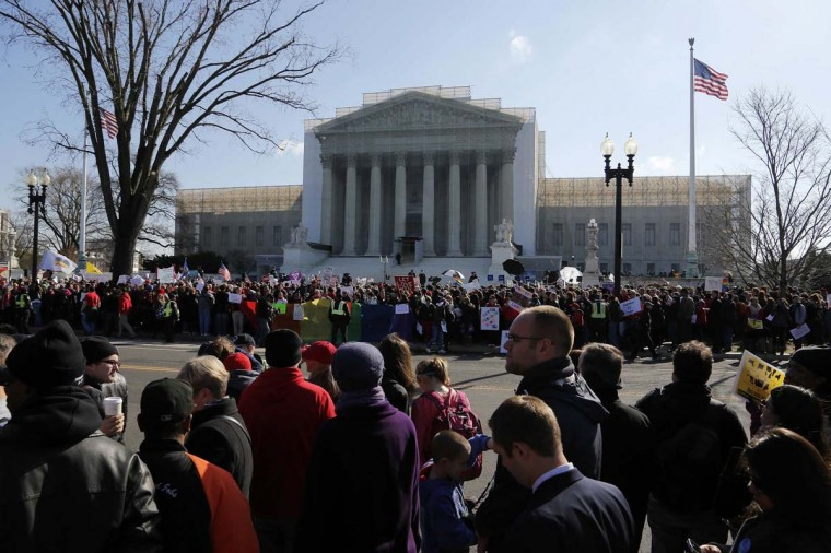 Anti-Proposition 8 protesters line both sides of the street in front of the U.S. Supreme Court in Washington March 26, 2013. (Jonathan Ernst/Reuters)