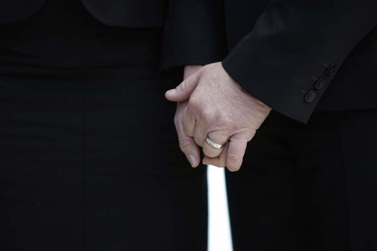 Plaintiffs Sandra B. Stier (L) and Kristin M. Perry hold hands outside the Supreme Court after their case against California's Proposition 8 was argued in Washington, March 26, 2013. (Jonathan Ernst/Reuters)