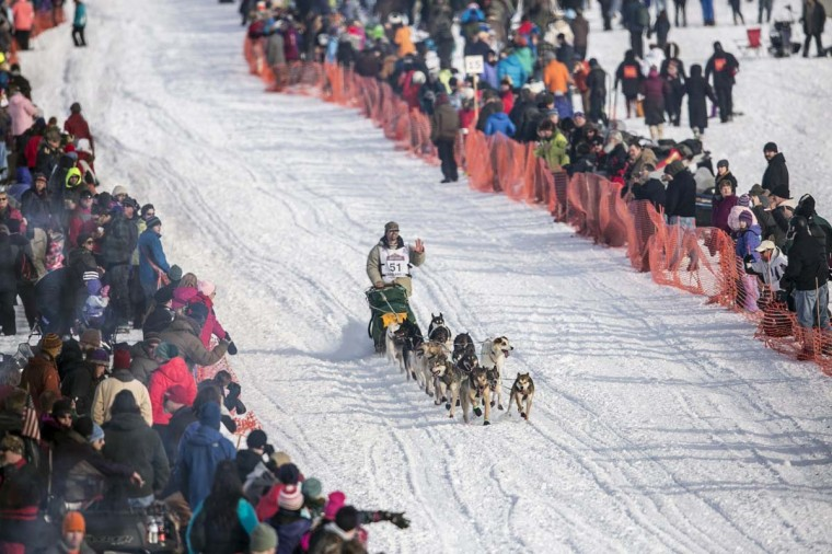 Cim Smyth's team races down the trail at the re-start of the Iditarod dog sled race in Willow, Alaska March 3, 2013. From Willow, the race runs for almost 1000 miles as it crosses the state. (Nathaniel Wilder/Reuters)