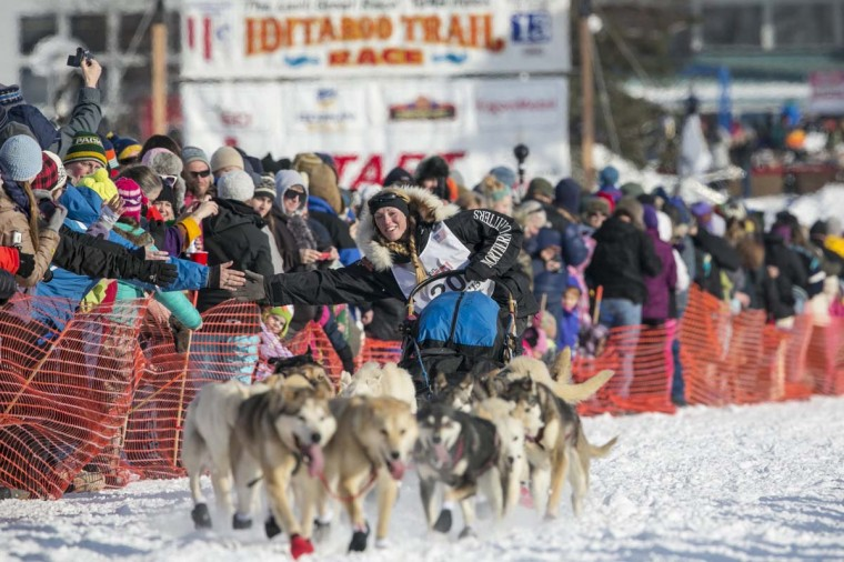 Kristy Berington greets fans as she heads out of the gate at the re-start of the Iditarod dog sled race in Willow, Alaska March 3, 2013. Berington has a twin who is also racing a team in the Iditarod this year. (Nathaniel Wilder/Reuters)